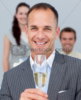 Cheerful businessman toasting with Champagne