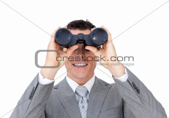 Visionary businessman looking to the future through binoculars