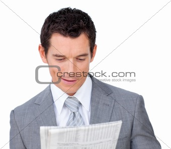 Charming businessman reading a newspaper
