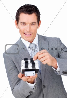 Assertive businessman searching for the index