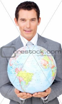 Assertive businessman holding a terrestrial globe