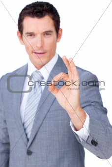 Charismatic businessman showing OK sign