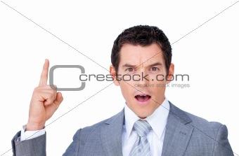 Astonished businessman pointing upward