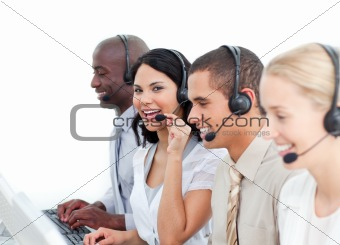 Brunette businesswoman and her team working in a call center