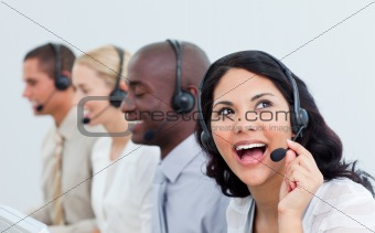 Animated businesswoman and her team working in a call center