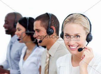 Blond businesswoman and her team working in a call center