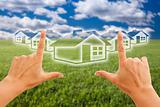 Female Hands Framing Houses Over Grass Field and Sky