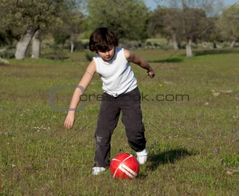 Small child playing soccer