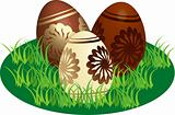 Decorated chocolate eggs in a stylized lawn
