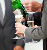 Close-up of a business person serving Champagne