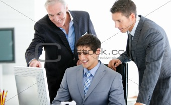 Positive businessmen working at a computer