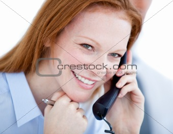 Positive businesswoman taling on phone
