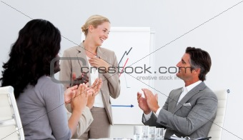 Smiling business people applauding a good presentation