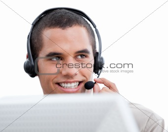 Attractive businessman with headset on working