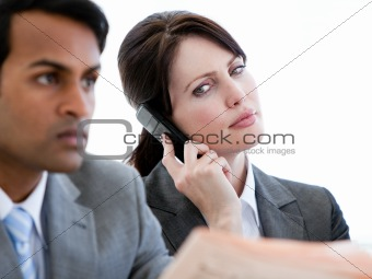 Beautiful businesswoman on phone in a waiting room