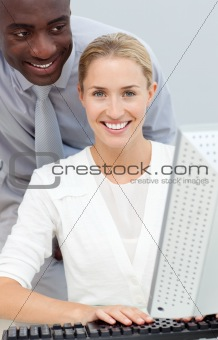 Afro-american businessman and his colleague working at a compute