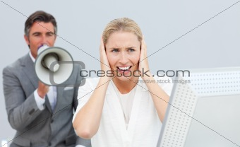 Angry businessman holding a megaphone