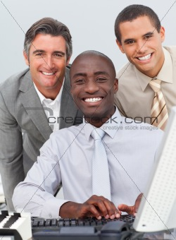 Smiling business group working at a computer