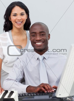 Multi-ethnic business team working at a computer