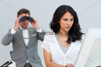 Ambitious businessman looking her colleague's computer through b