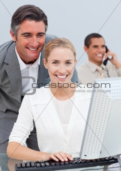 Smiling business team working in the office