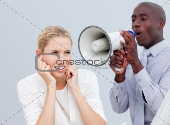 Ambitious businessman shouting through a megaphone