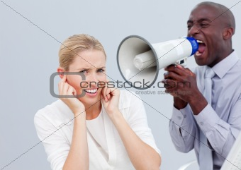 A businessman shouting through a megaphone