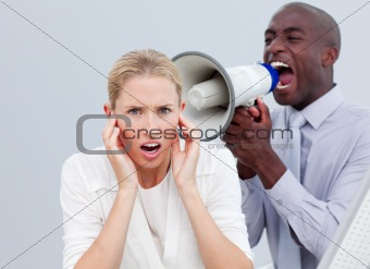 Furious businessman shouting through a megaphone