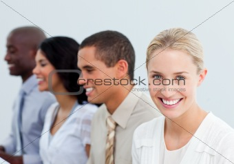 Blond businesswoman and her team at work