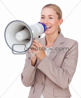 Attractive businesswoman shouting through a megaphone