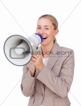 Laughing businesswoman shouting through a megaphone