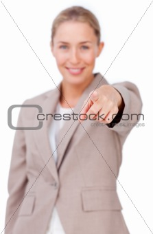 Assertive businesswoman pointing at the camera