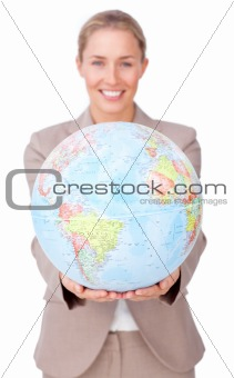 Confident businesswoman holding a terrestrial globe