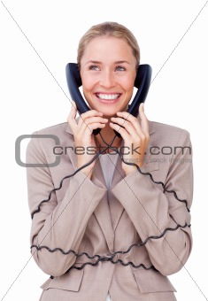 Charming businesswoman tangled up in phone wires