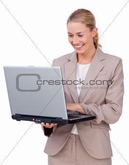 Charismatic businesswoman using a laptop