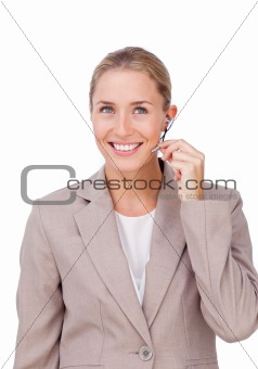 Charismatic blond businesswoman using headset