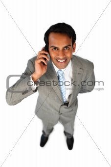 Positive ethnic businessman on phone
