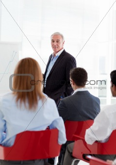 A diverse group of business people at a seminar