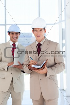 Portrait of two architects wearing hard hat