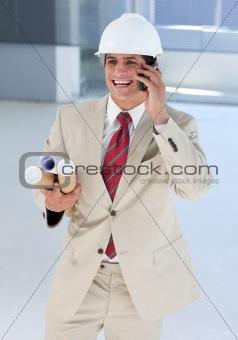 Smiling architect on phone