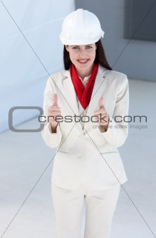 Beautiful female architect wearing a hard hat