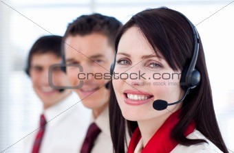 Business team with headset on smiling at the camera