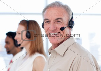 Smiling business manager in a call center