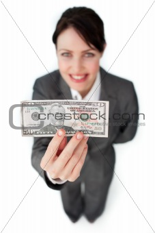Charming businesswoman showing a bank note