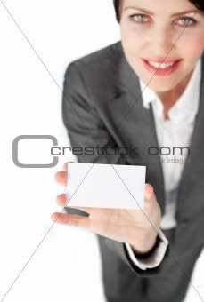 Charismatic businesswoman showing a white card