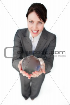 Smiling businesswoman holding a crystal ball