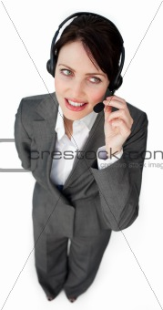 Beautiful young businesswoman talking on a headset