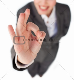 Close-up of a businesswoman showing OK sign