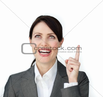 Glowing businesswoman pointing at a copyspace