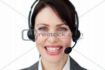 Bright female executive with headset